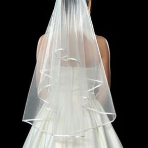 Two tier white or ivory veil with ribbon edging.